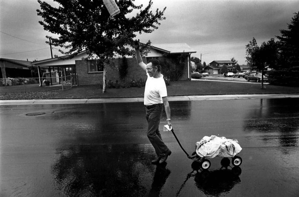 . Aurora School Board Prexy, Bill Davis, \'Moonlights\' on Son\'s Paper Route. (Photo by Kenn Bisio/The Denver Post Archive)