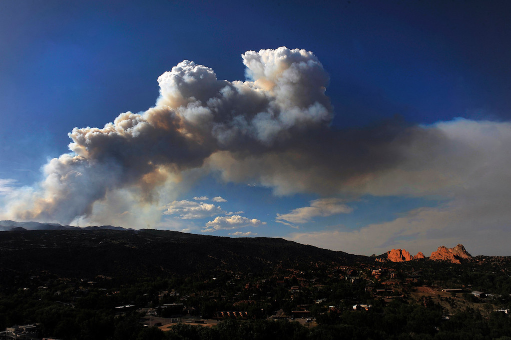 . The plume from the Waldo Canyon fire burning west of Colorado Springs looms over Garden of the Gods at right, June 25th, 2012. The fire was 5% contained. Helen H. Richardson, The Denver Post