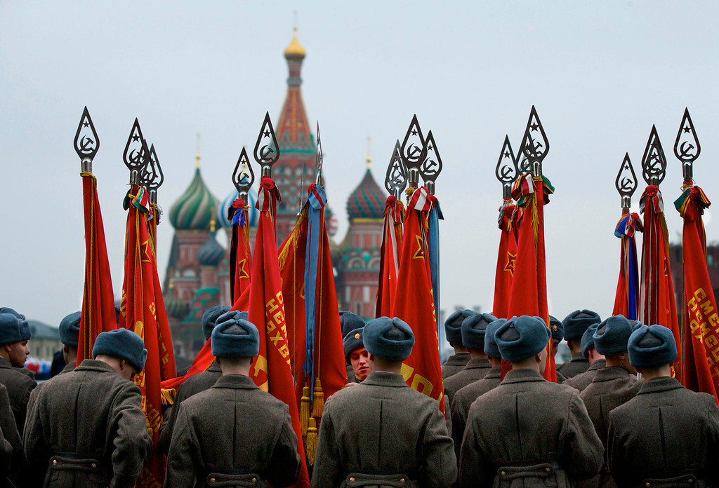 . Russian soldiers dressed in Red Army World War II uniforms prepare to parade in Red Square in Moscow, Russia, Thursday, Nov. 7, 2013. Thousands of Russian soldiers and military cadets marched across Red Square to mark the 72nd anniversary of a historic World War II parade. The show honored the participants of the Nov. 7, 1941 parade who then headed directly to the front to defend Moscow from the Nazi forces. The parade Thursday involved about 6,000 people, many of them dressed in World War II-era uniforms. (AP Photo/Alexander Zemlianichenko)