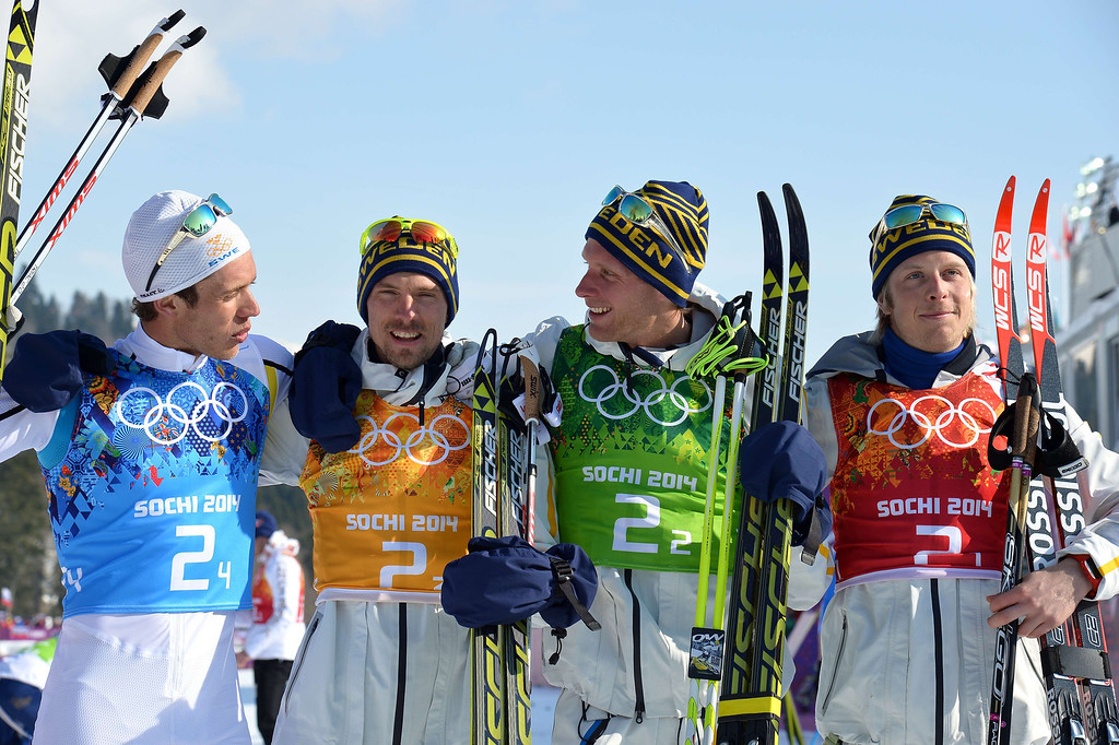 . Sweden\'s gold medalists (L-R) Marcus Hellner, Johan Olsson, Daniel Richardsson and Lars Nelson pose for pictures after the Men\'s Cross-Country Skiing 4 x 10km Relay Flower Ceremony at the Laura Cross-Country Ski and Biathlon Center during the Sochi Winter Olympics on February 16, 2014 in Rosa Khutor near Sochi.  ALBERTO PIZZOLI/AFP/Getty Images