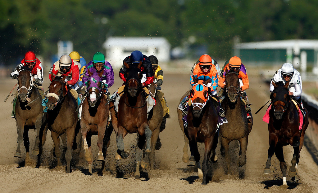. California Chrome, third from left,, is flanked by Wicked Strong and Tonalist as they run down the backstretch during the 146th running of the Belmont Stakes horse race at Belmont Park, Saturday, June 7, 2014, in Elmont, N.Y.  Tonalist went on to win the race, denying California Chrome the Triple Crown victory. (AP Photo/Jason DeCrow)