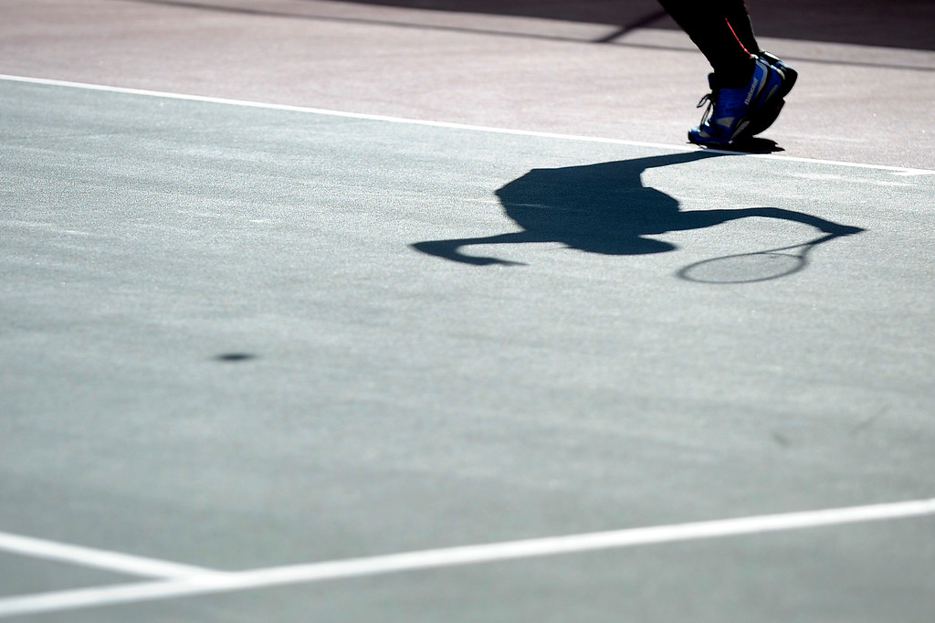 . DENVER, CO. - OCT 12:   Ignatius Castelino, of Fairview, serves against Cherry Creek\'s Zach Fryer. The pair played in the #1 singles match on the final day of the 5A Boys\' Tennis Championships at Gates Tennis Center on Oct. 12, 2013.  (Photo By Erin Hull/The Denver Post)