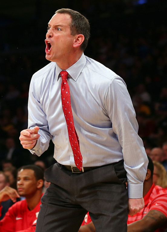 . Head coach Mike Rice of the Rutgers Scarlet Knights directs his players in the first half against the DePaul Blue Demons at Madison Square Garden on March 12, 2013 in New York City.  (Photo by Elsa/Getty Images)