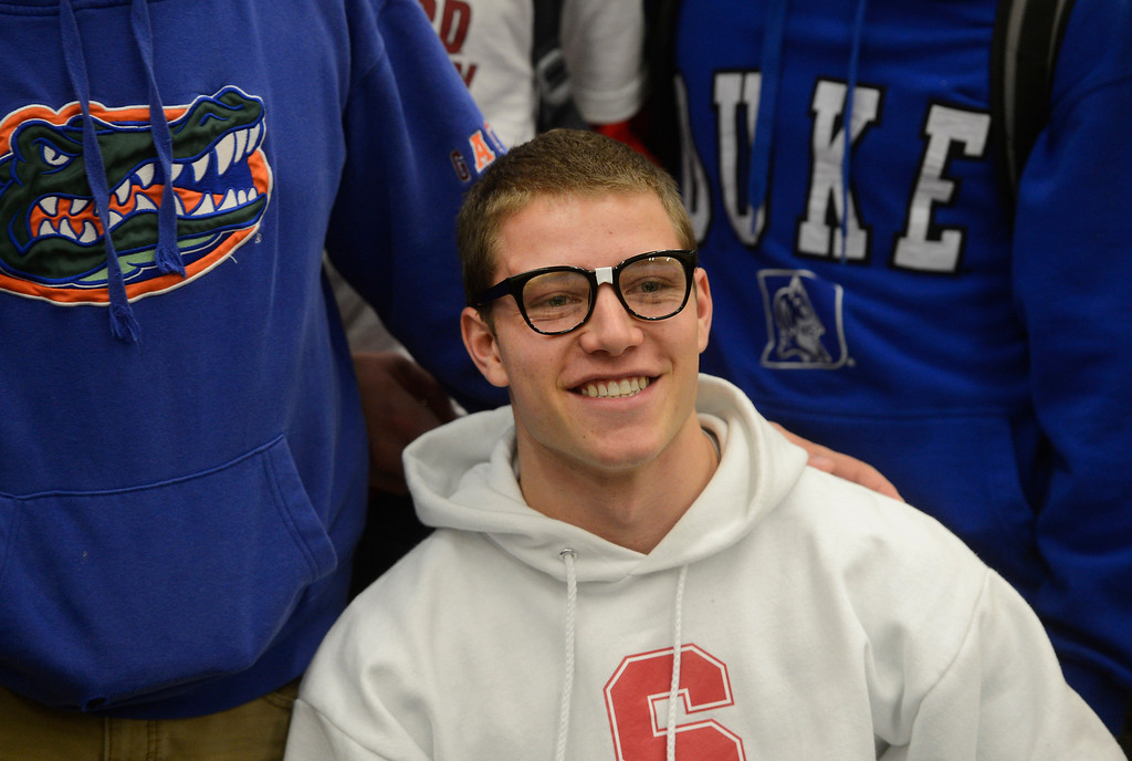 . HIGHLANDS RANCH, CO. - FEBRUARY 05: Valor Christian High School senior, Christian McCaffrey, sports �nerd� glasses while posing for a picture for his mother, Lisa, (not pictured) before Christian and 24 other Valor athletes signed their college letter of intent during National Letter of Intent Day at Valor Wednesday morning, February 05, 2014. McCaffrey, a national high school football standout, signed with Stanford University. (Photo By Andy Cross / The Denver Post)
