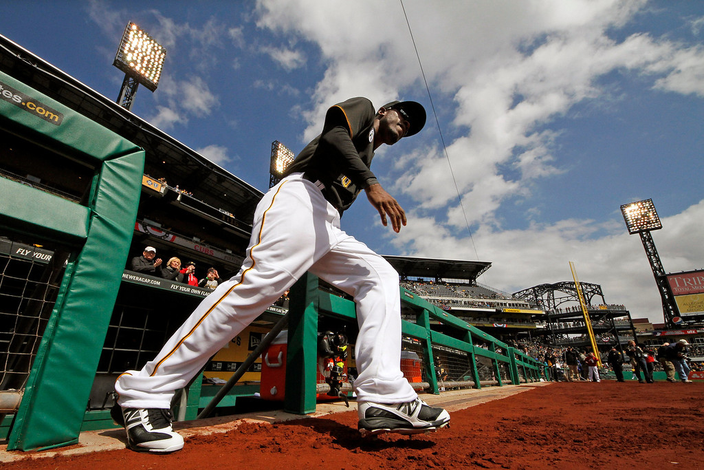 . Pittsburgh Pirates left fielder Starling Marte (6) runs out of the dugout after being introduced on opening day at PNC Park in Pittsburgh before a baseball game against the Chicago Cubs in Pittsburgh, Monday, April 1, 2013. The Cubs won 3-1. (AP Photo/Gene J. Puskar)