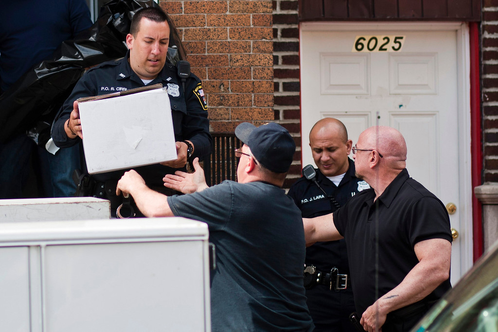 . West New York Police officers collect evidence from the apartment of Alina Tsarnaeva, sister of the Boston Marathon bombing suspects, in West New York, New Jersey April 19, 2013. REUTERS/Eduardo Munoz