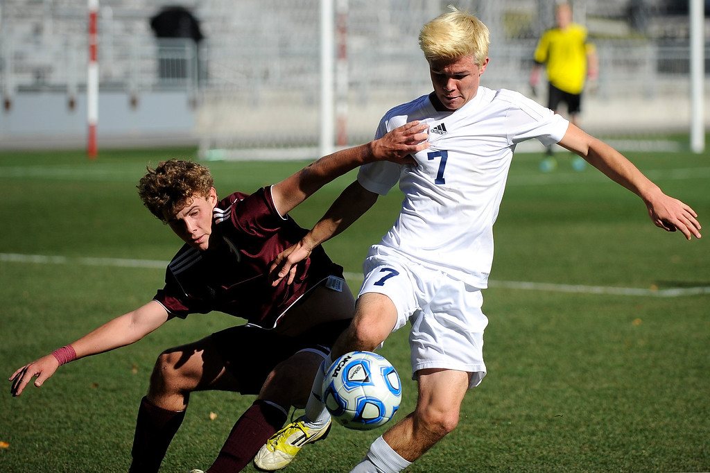 . DENVER CO: Nov. 9, 2013  Air Academy player Austin Dewing fights for the ball during the second half of play in the 4A State Championship at Dick\'s Sporting Goods Park on Nov. 9, 2013.   (Photo By Erin Hull/The Denver Post)