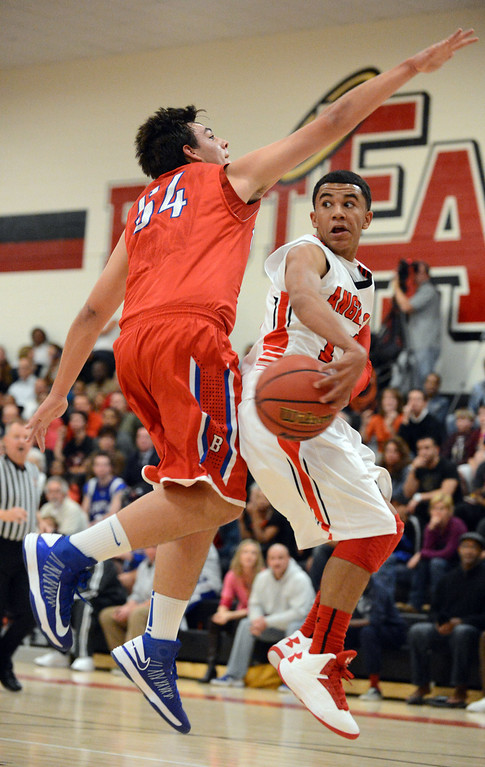 . East\'s Brian Carey, right, controls the ball against Cherry Creek\'s Dylan Schneider in the 1st half of the game at East High School on Friday, Nov. 30, 2012. Hyoung Chang, The Denver Post