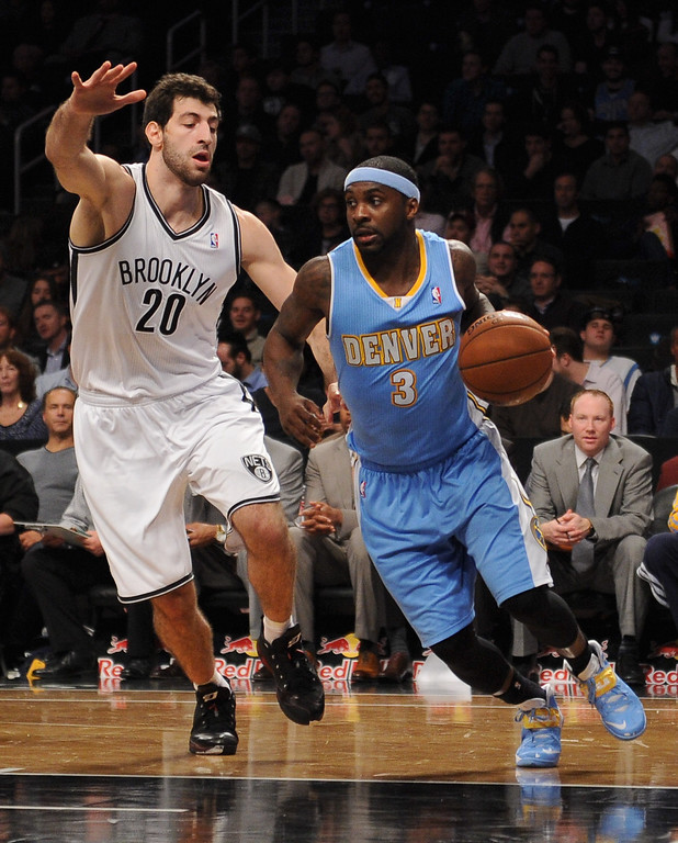 . NEW YORK, NY - DECEMBER 03:  Ty Lawson #3 of the Denver Nuggets dribbles against Tornike Shengelia #20 of the Brooklyn Nets during the first half at Barclays Center on December 3, 2013 in the Brooklyn borough of New York City.  (Photo by Maddie Meyer/Getty Images)