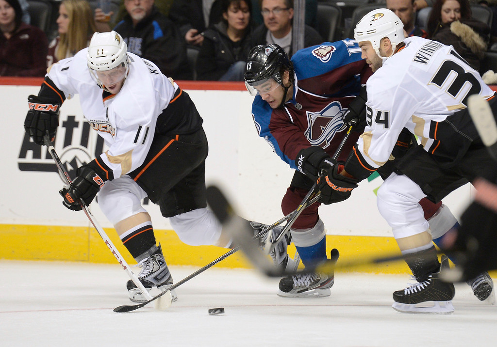 . DENVER, CO. - FEBRUARY 06: P.A. Parenteau (15) of the Colorado Avalanche loses control of the puck to Saku Koivu (11) of the Anaheim Ducks and Daniel Winnik (34) of the Anaheim Ducks during the third period February 6, 2013 at Pepsi Center. The Colorado Avalanche fall to the Anaheim Ducks  3-0 during NHL action. (Photo By John Leyba / The Denver Post)