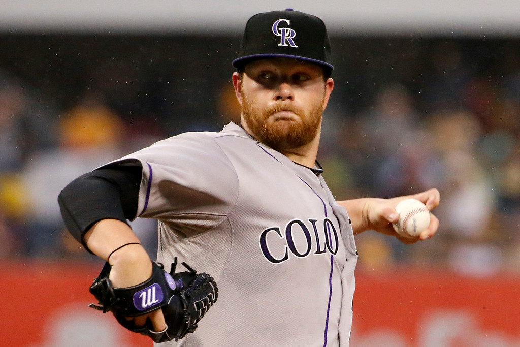 . Colorado Rockies starting pitcher Brett Anderson (30) delivers during the first inning of a baseball game against the Pittsburgh Pirates in Pittsburgh Saturday, July 19, 2014. (AP Photo/Gene J. Puskar)