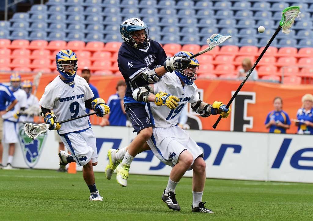 . DENVER, CO. - MAY 18 : Scott Moore of Wheat Ridge High School (19) and Ozzie Christensen of Air Academy High School (12) are fighting for the control of free ball by Rocco Conca of Wheat Ridge High School (9) during 4A Boy\'s Lacrosse Championship game at Sports Authority Field at Mile High Stadium. Denver, Colorado. May 18, 2013. (Photo By Hyoung Chang/The Denver Post)