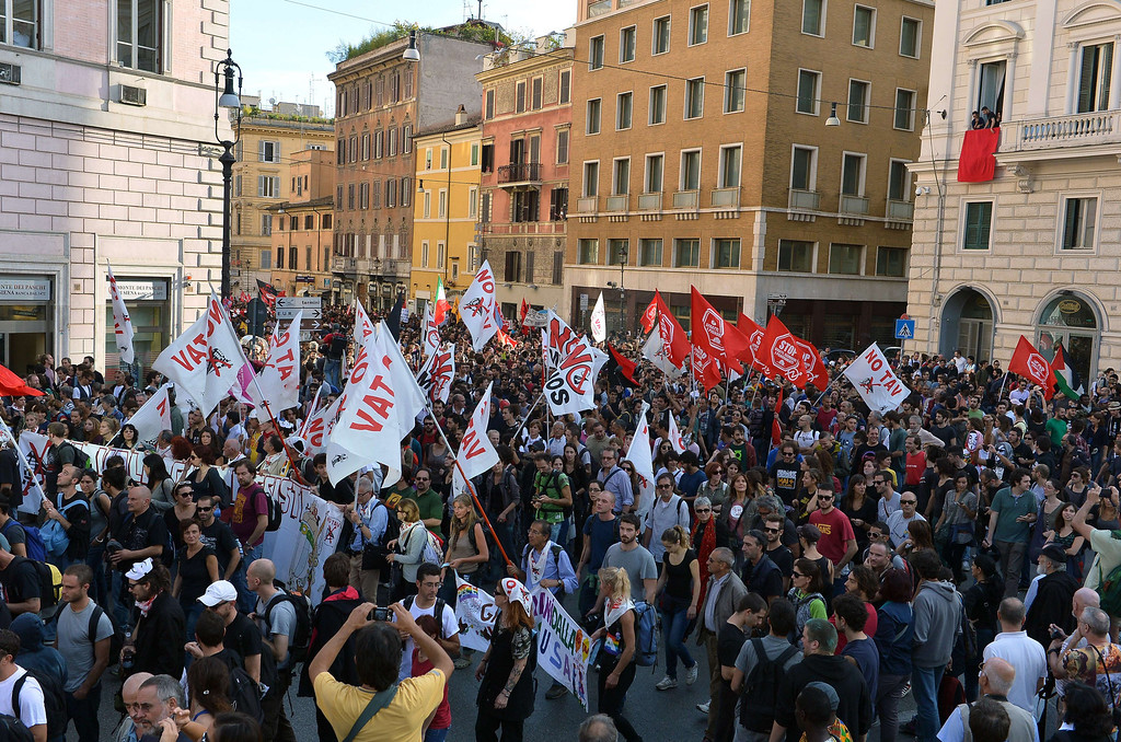 . Thousands of people march during an anti-austerity protest on October 19, 2013 in Rome. Between 3,000 and 4,000 police officers have been deployed, Italian media reports said, and protest organizers say they expect more than 20,000 to join.  ALBERTO PIZZOLI/AFP/Getty Images