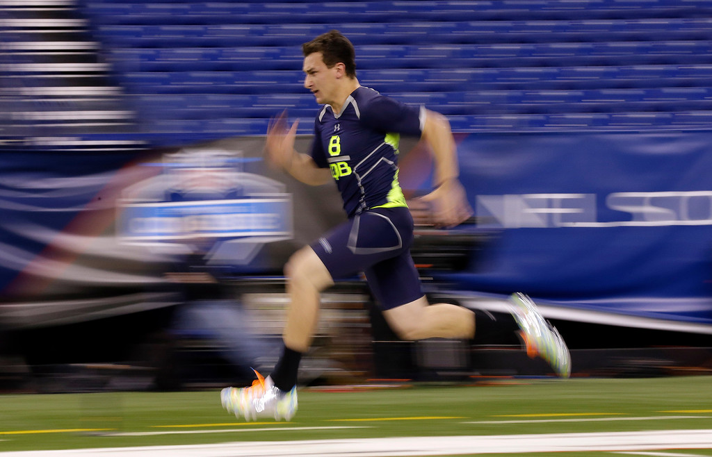 . Texas A&M quarterback Johnny Manziel runs the 40-yard dash at the NFL football scouting combine in Indianapolis, Sunday, Feb. 23, 2014. (AP Photo/Michael Conroy)