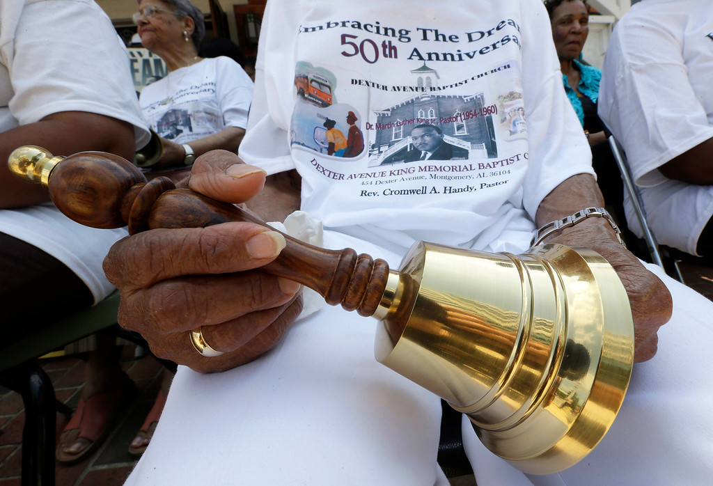 ". Jeanne Smiley of Montgomery, Ala., holds her bell during ceremonies honoring the 50th anniversary of the Martin Luther King Jr., ""I Have a Dream\"" speech in Montgomery, Ala., Wednesday, Aug. 28, 2013. The ceremony took place outside the Dexter Ave. King Memorial Baptist Church where King became pastor in 1954. Smiley said \""Rev. King was a great man who helped make this country a better place to live.\"" (AP Photo/Dave Martin)"