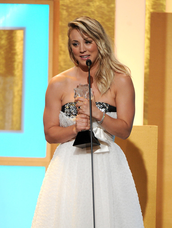". Kaley Cuoco accepts the award for best supporting actress in a comedy series for ""The Big Bang Theory\"" at the Critics\' Choice Television Awards in the Beverly Hilton Hotel on Monday, June 10, 2013, in Beverly Hills, Calif. (Photo by Frank Micelotta/Invision/AP)"