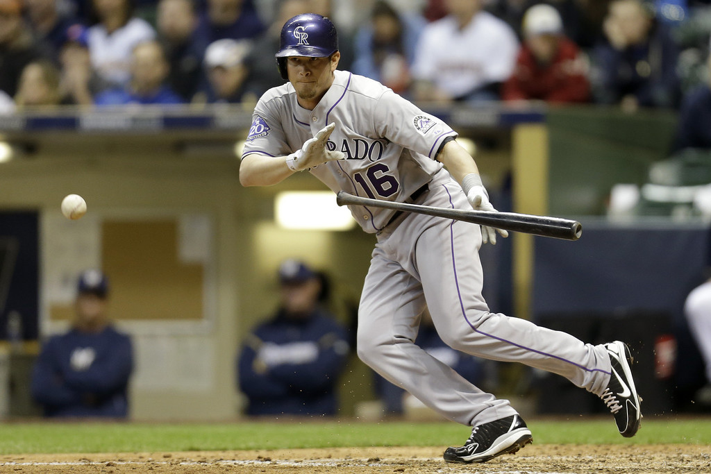 . MILWAUKEE, WI - APRIL 2: Reid Brignac #16 of the Colorado Rockies lays down a scracrifice bunt to move Yorvit Torrealba into scoring postion in the top of the 8th inning against the Milwaukee Brewers at Miller Park on April 2, 2013 in Milwaukee, Wisconsin. (Photo by Mike McGinnis/Getty Images)