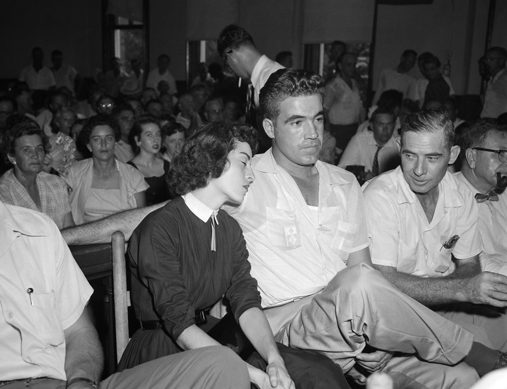 """. Carolyn Bryant rests her head on her husband Roy Bryant\'s shoulder after she testified in Emmett Till\'s murder court case in Sumner, Miss., Sept. 22. 1955.  Bryant is accused of murdering the 14-year-old Chicago native, who is black, for \""""wolf-whistling\"""" at his wife.  (AP Photo)"""
