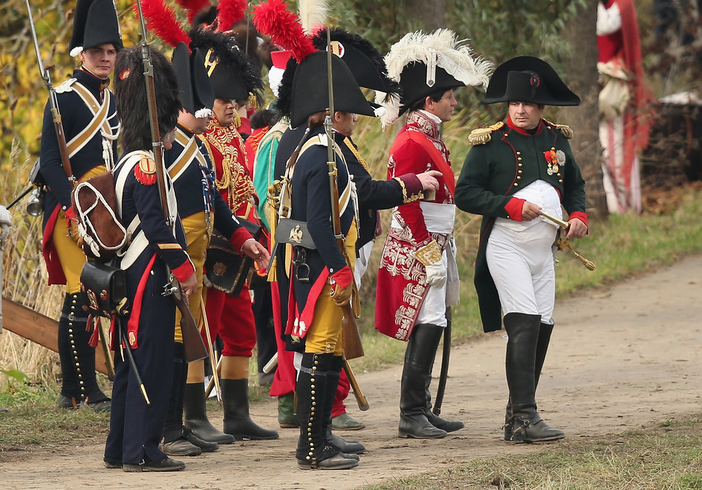 . A historical society enthusiast in the role of Napoleon (R) walks with members of his commanding staff during the re-enactment of The Battle of Nations on its 200th anniversary on October 20, 2013 near Leipzig, Germany.  (Photo by Sean Gallup/Getty Images)