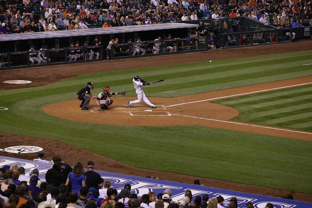 . Troy Tulowitzki #2 of the Colorado Rockies hits a solo home run off of starting pitcher Madison Bumgarner #40 of the San Francisco Giants to take a 1-0 lead in the fifth inning at Coors Field on April 22, 2014 in Denver, Colorado.  (Photo by Doug Pensinger/Getty Images)