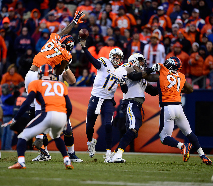 . San Diego Chargers quarterback Philip Rivers (17) makes a pass in the third quarter. The Denver Broncos take on the San Diego Chargers at Sports Authority Field at Mile High in Denver on January 12, 2014. (Photo by AAron Ontiveroz/The Denver Post)
