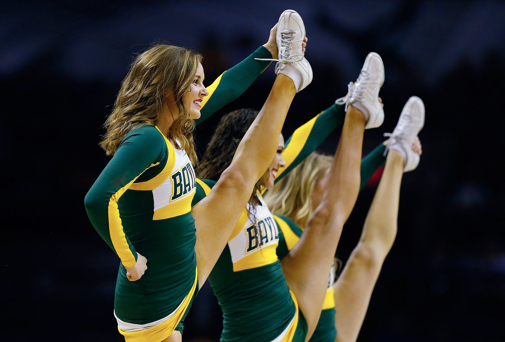 . Baylor Bears cheerleaders perform during the third round of the 2014 NCAA Men\'s Basketball Tournament against the Creighton Bluejays at the AT&T Center on March 23, 2014 in San Antonio, Texas.  (Photo by Tom Pennington/Getty Images)