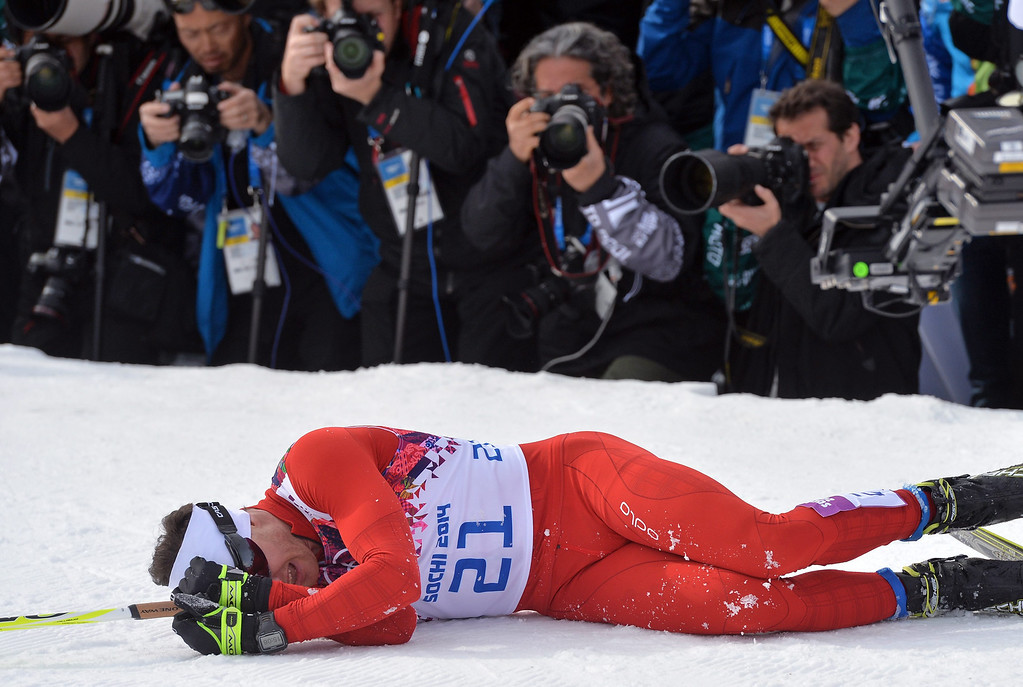 . Dario Cologna of Switzerland reacts in front of the photographers after winning the gold medal during the Men\'s 15km + 15km Skiathlon competition in the Laura Cross Country Center at the Sochi 2014 Olympic Games, Krasnaya Polyana, Russia.  EPA/HENDRIK SCHMIDT