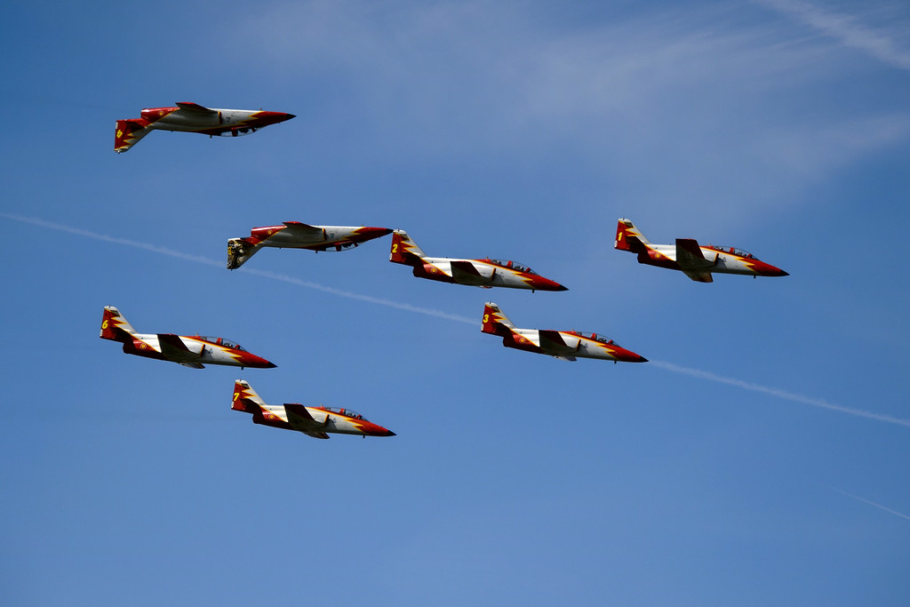 """. The Spanish Air Force\'s \""""Patrulla Aguila\"""" aerobatic team performs on the first day of the AIR14 air show in Payerne, western Switzerland, on August 30, 2014.  AFP PHOTO / FABRICE  COFFRINI/AFP/Getty Images"""