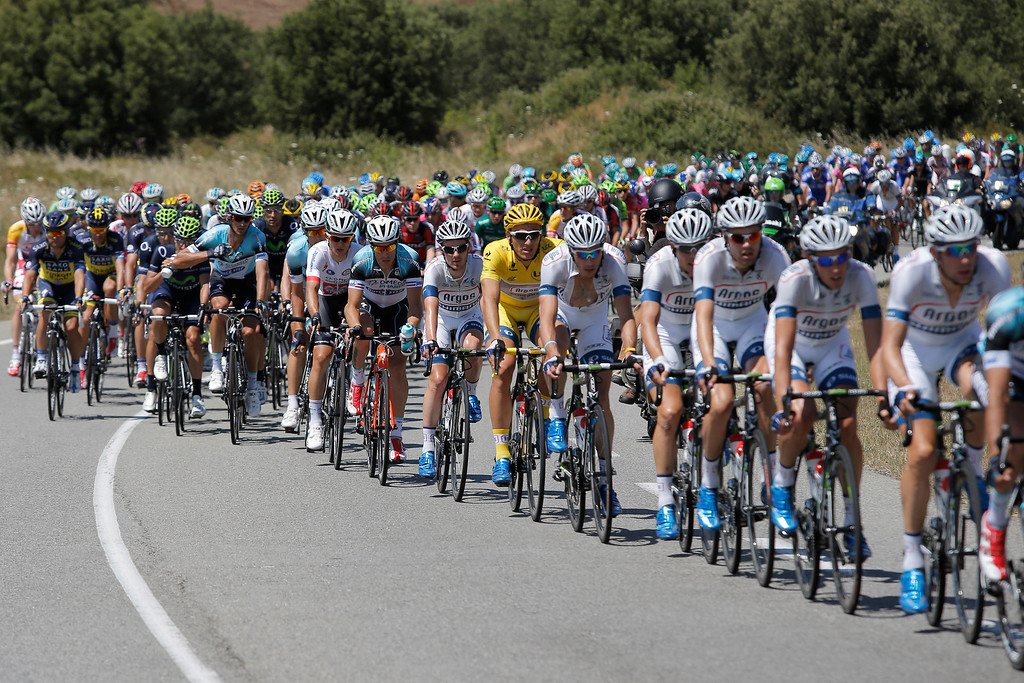 . Marcel Kittel of Germany, wearing the overall leader\'s yellow jersey, rides with his Argos-Shimano teammates, in white, in the pack during the second stage of the Tour de France cycling race over 156 kilometers (97.5 miles) with start in Bastia and finish in Ajaccio, Corsica island, France, Sunday June 30, 2013. (AP Photo/Laurent Cipriani)