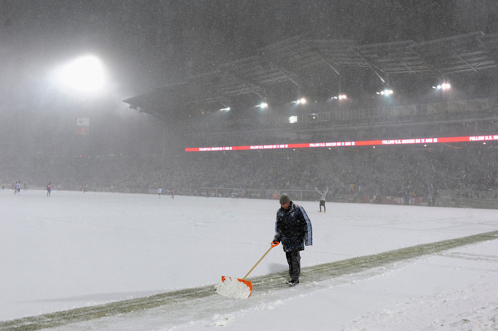 . COMMERCE CITY, CO. - MARCH 22: Crews attempted to keep the end lines visible as the game neared the halfway point Friday night. The U.S. Men\'s National Soccer Team hosted Costa Rica Friday night, March 22, 2013 in a FIFA World Cup qualifier at Dick\'s Sporting Goods Park in Commerce City.  (Photo By Karl Gehring/The Denver Post)
