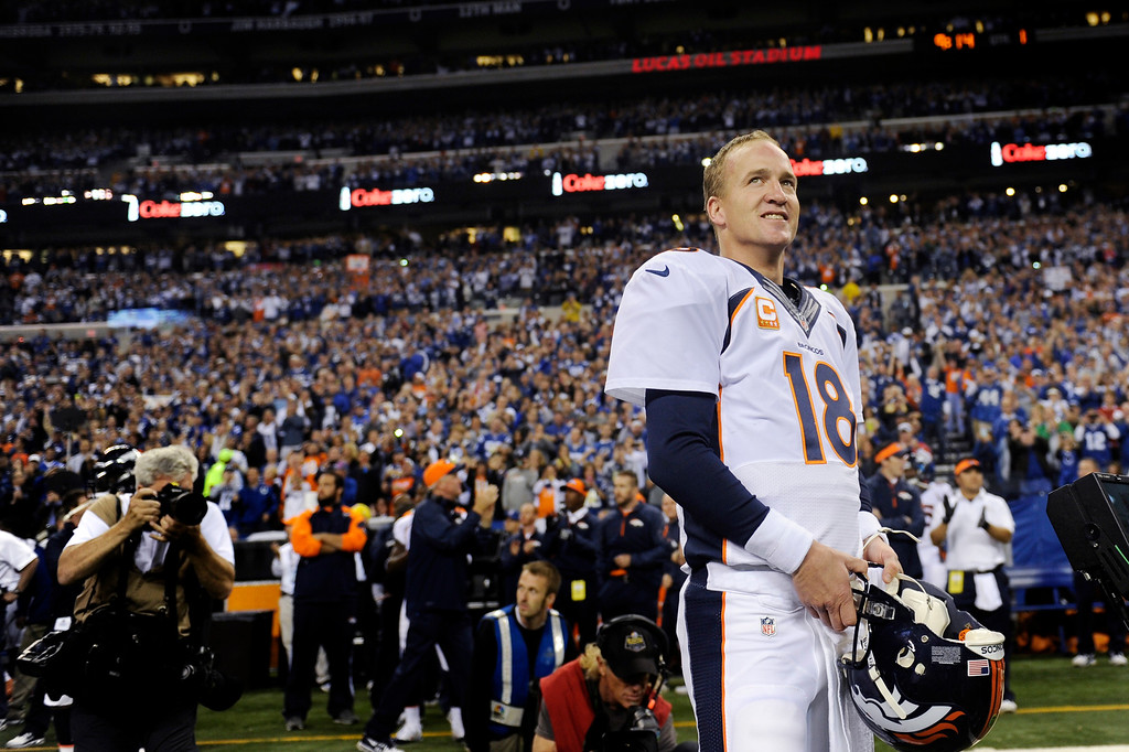. Quarterback Peyton Manning (18) of the Denver Broncos acknowledges the crowd before his game against the Indianapolis Colts at Lucas Oil Stadium on Sunday, October 20, 2013 Indianapolis, Indiana. (Photo By Joe Amon/The Denver Post)