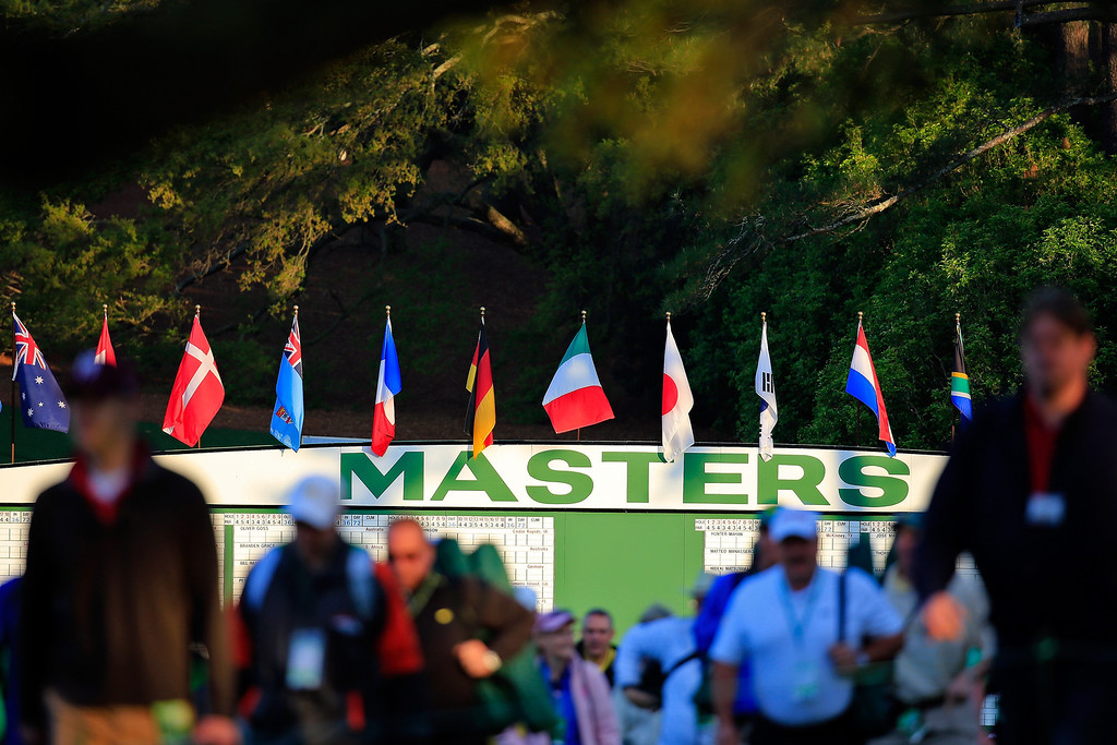 . Patrons enter the course during a practice round prior to the start of the 2014 Masters Tournament at Augusta National Golf Club on April 9, 2014 in Augusta, Georgia.  (Photo by Rob Carr/Getty Images)