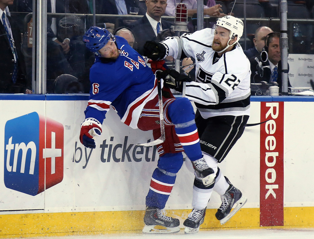 . Trevor Lewis #22 of the Los Angeles Kings checks Anton Stralman #6 of the New York Rangers during the second period of Game Four of the 2014 NHL Stanley Cup Final at Madison Square Garden on June 11, 2014 in New York, New York.  (Photo by Bruce Bennett/Getty Images)