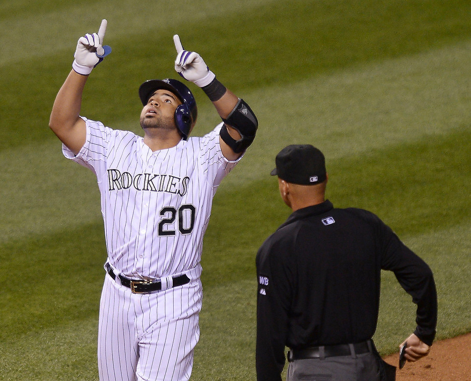 . Colorado\'s Wilin Rosario pointed to the heavens following his game-equalizing home run in the sixth inning.   (Photo by Karl Gehring/The Denver Post)