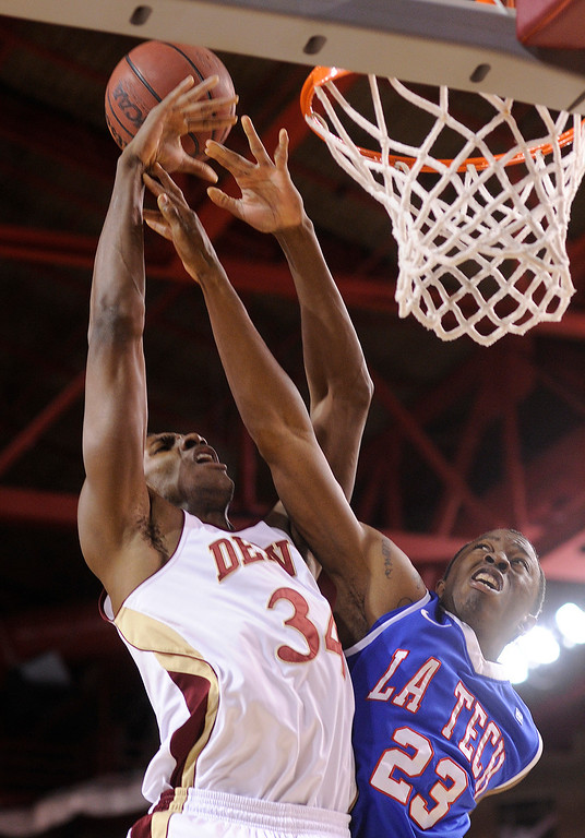 . Bulldogs guard Jaron Johnson (23) fouled Pioneers Chris Udofia (34) under the basket in the first half. The University of Denver men\'s basketball team hosted the Louisiana Tech Bulldogs at Magness Arena Saturday night, March 9, 2013. (Photo By Karl Gehring/The Denver Post)