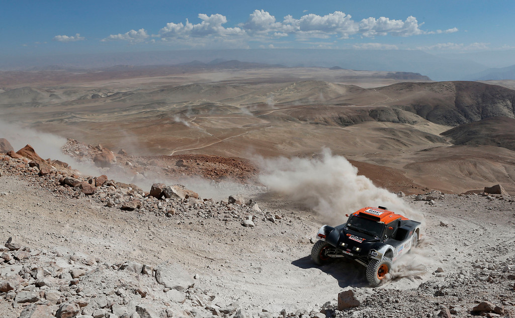 . Guerlain Chicherit and co-driver Jean-Pierre Garcin, both of France, compete in the 4nd stage of the 2013 Dakar Rally from Nazca to Arequipa, Peru, Tuesday, Jan. 8, 2013. The race finishes in Santiago, Chile, on Jan. 20. (AP Photo/Victor R. Caivano)