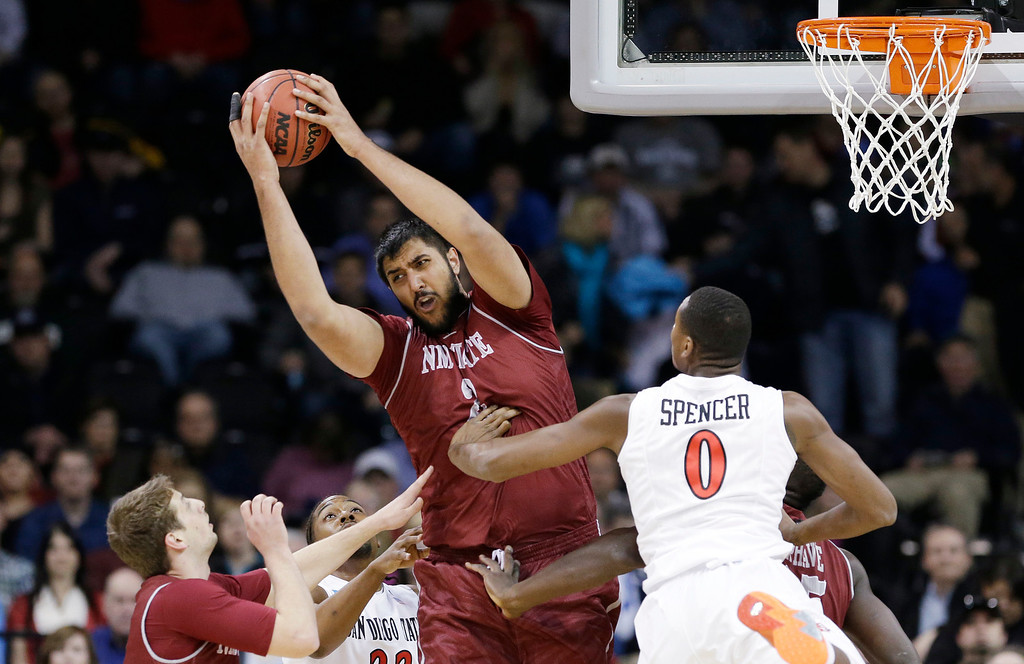 . New Mexico State\'s Sim Bhullar grabs a rebound against San Diego State in the first half of a second-round game in the NCAA men\'s college basketball tournament in Spokane, Wash., Thursday, March 20, 2014. (AP Photo/Elaine Thompson)
