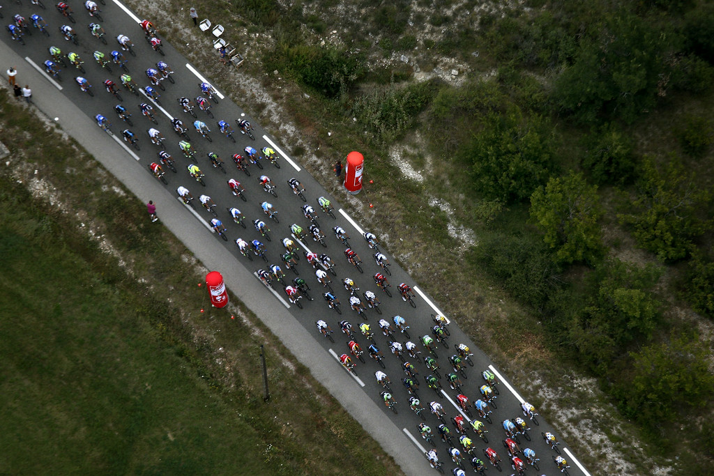 . The pack rides during the 222 km fifteenth stage of the 101st edition of the Tour de France cycling race on July 20, 2014 between Tallard and Nimes, southern France.  KIM LUDBROOK/AFP/Getty Images