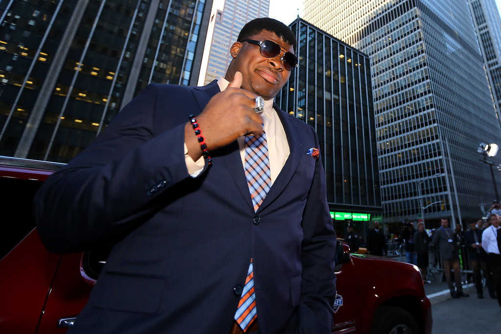 . D.J. Fluker of the Alabama Crimson Tide arrives on the red carpet for the first round of the 2013 NFL Draft at Radio City Music Hall on April 25, 2013 in New York City.  (Photo by Al Bello/Getty Images)