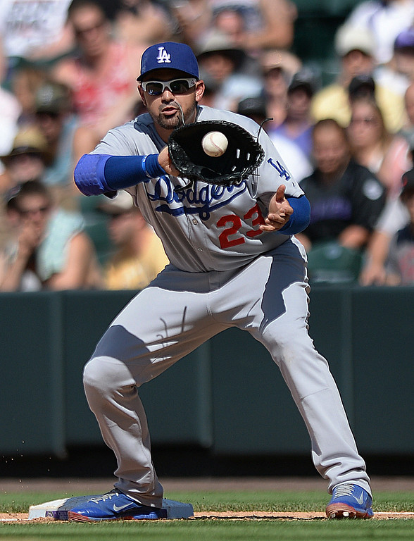 . DENVER, CO - JULY 5:  Los Angeles infielder Adrian Gonzalez took a pick off attempt at first base in the sixth inning. The Colorado Rockies defeated the Los Angeles Dodgers 8-7 at Coors Field Saturday afternoon, July 5, 2014.  Photo by Karl Gehring/The Denver Post