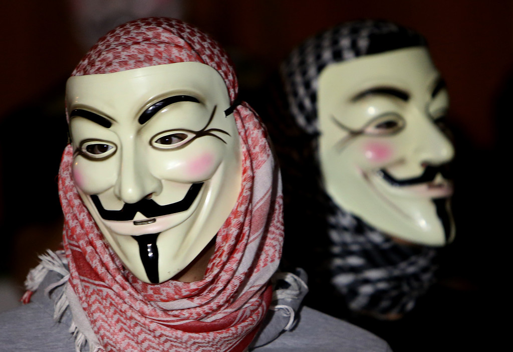 . Lebanese activists wear masks as they protest against corrupt governments and corporations, in support of the anonymous activist moment, at the Martyrs square, in downtown Beirut, Lebanon, Tuesday, Nov 5, 2013, as part of a Million Mask March of similar rallies around the world on Guy Fawkes Day. (AP Photo/Hussein Malla)