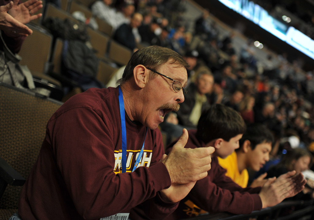 . DENVER, CO. - FEBRUARY 22: Bob Detterson of Brush cheers his son Alec, 132 pound class of Brush High School, during State Championship tournament at Pepsi Center February 22, 2013. Denver, Colorado. (Photo By Hyoung Chang/The Denver Post)
