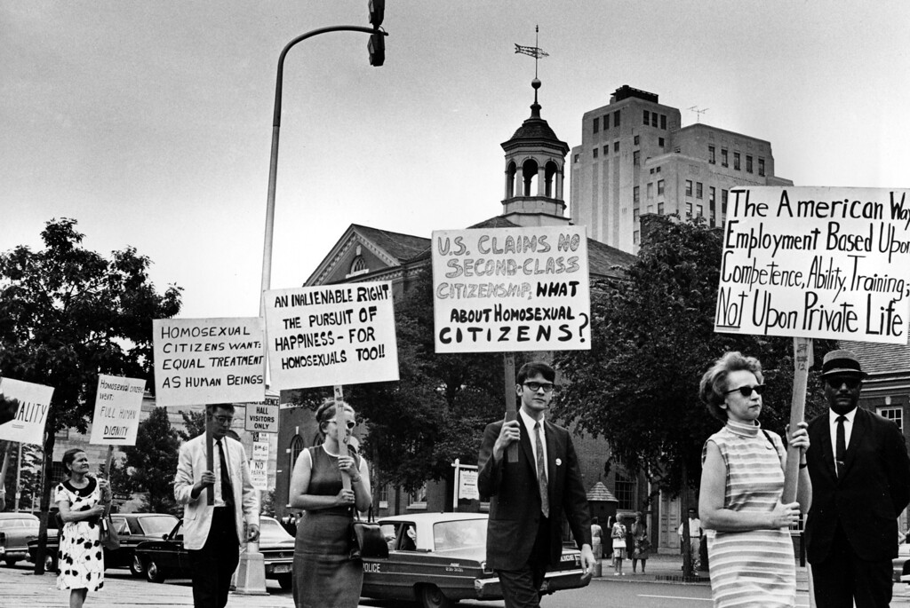 . Demonstrators carry signs calling for protection of homosexuals from discrimination as they march in a picket line in front of Independence Hall in Philadelphia, July 4, 1967. (AP)