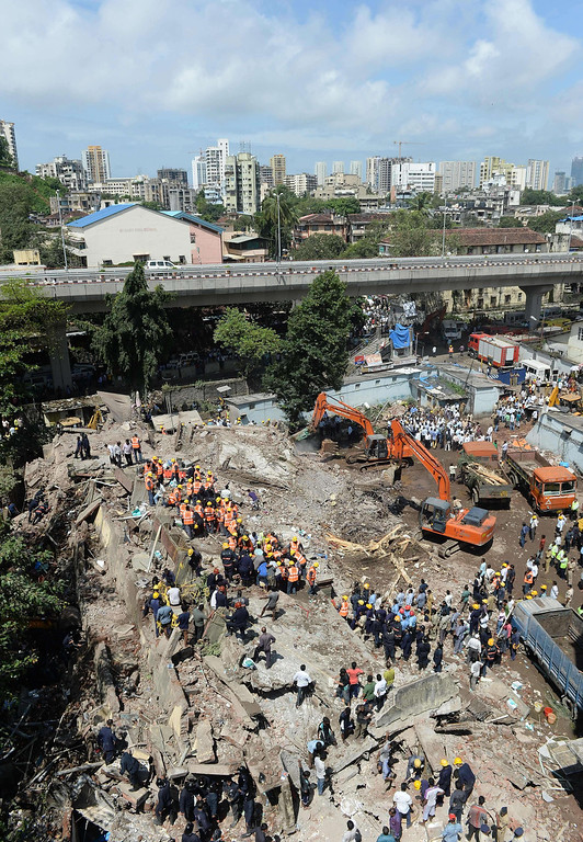 . Firefighters and rescue workers search for survivors at the site of a building collapse in Mumbai on September 27, 2013. AFP PHOTO/Indranil MUKHERJEE/AFP/Getty Images