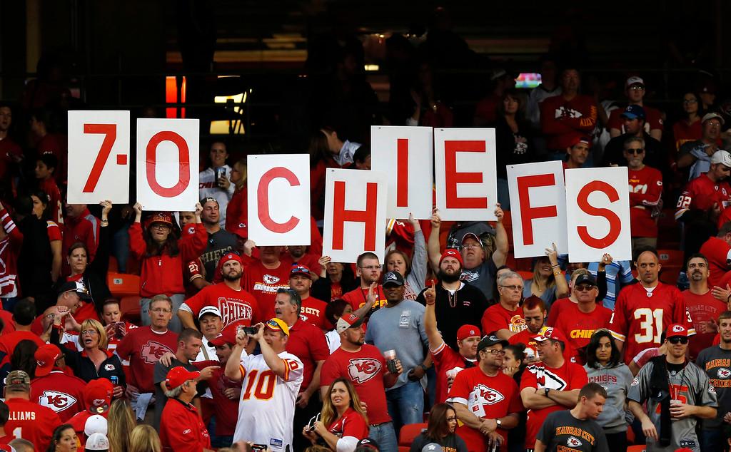 . Kansas City Chiefs fans hold up the teams record following an NFL football game against the Houston Texans at Arrowhead Stadium in Kansas City, Mo., Sunday, Oct. 20, 2013. The Chiefs defeated the Texans 17-16. (AP Photo/Ed Zurga)
