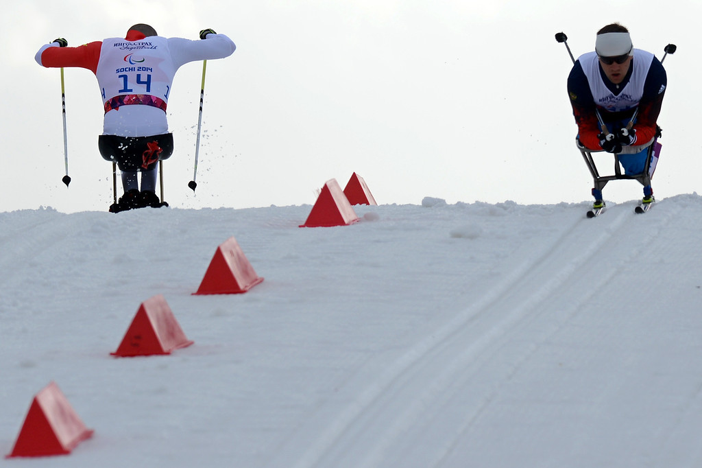 . Russia\'s Roman Petushkov (R) competes to the first place during the Men\'s 15 km Cross-Country Ski Sitting at XI Paralympic Olympic games in the Rosa Khutor stadium nearSochi on March 9, 2014.  KIRILL KUDRYAVTSEV/AFP/Getty Images