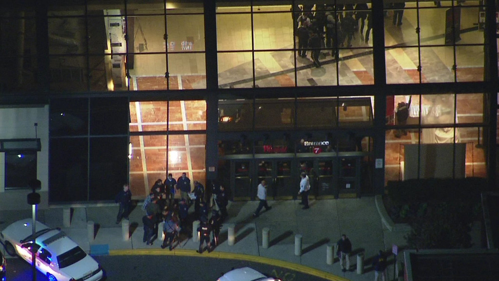 . In this image provided by News 12 New Jersey, authorities work the scene at Garden State Plaza Mall, late Monday, Nov. 4, 2013, in Paramus, N.J., after there were reports of multiple shots being fired inside the mall. (AP Photo/News 12 New Jersey)