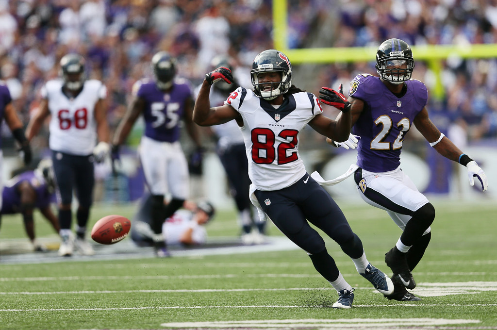 . Wide receiver Keshawn Martin #82 of the Houston Texans reacts after missing a pass while being covered by cornerback Jimmy Smith #22 of the Baltimore Ravens during the second half of the Ravens 30-9 win at M&T Bank Stadium on September 22, 2013 in Baltimore, Maryland.  (Photo by Rob Carr/Getty Images)