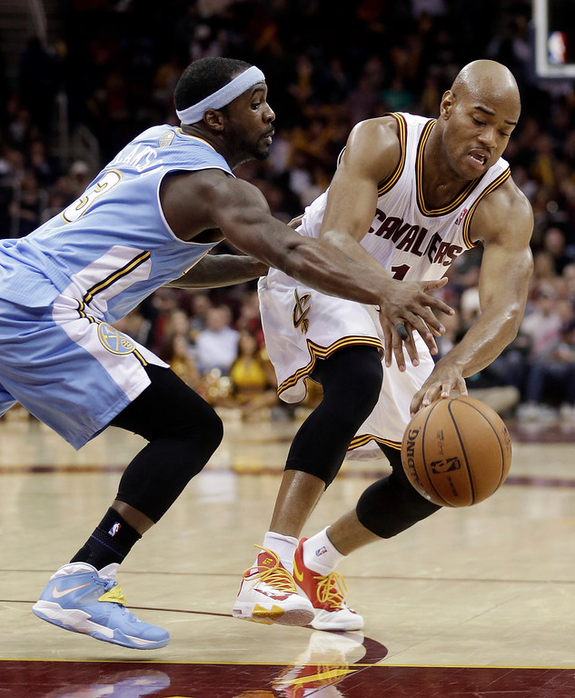 . Denver Nuggets\' Ty Lawson, left, puts pressure on Cleveland Cavaliers\' Jarrett Jack during the fourth quarter of an NBA basketball game on Wednesday, Dec. 4, 2013, in Cleveland. The Cavaliers won 98-88. (AP Photo/Tony Dejak)