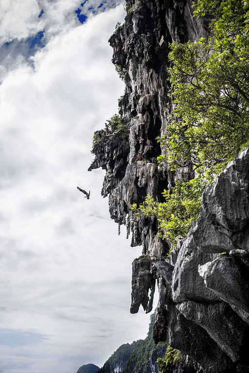 . In this handout image provided by Red Bull, Anatoliy Shabotenko of the Ukraine dives from a 25 meter rock at Viking Caves in the Andaman Sea during competition on the fifth day of the final stop of the 2013 Red Bull Cliff Diving World Series on October 24, 2013 at Phi Phi Island, Thailand. (Photo by Romina Amato/Red Bull via Getty Images)